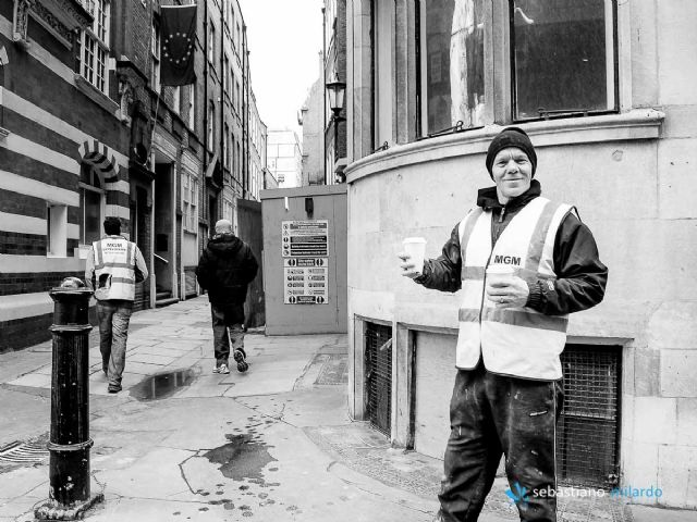 ...A SMILING WORKER IN LONDON CITY...